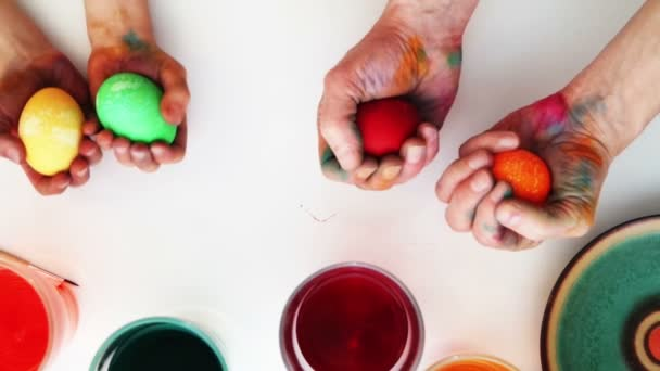 Colorful easter eggs in hands. Top view
