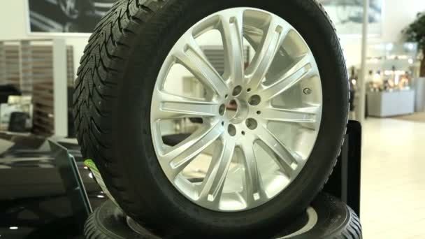 New car tyre with disk. Selling a new automobile wheel. View of row new car at new car showroom. Brand New Cars in Stock.