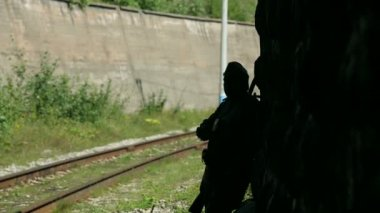 Actor dressed in military uniforms. Soldiers of the Soviet army smokes. The army of the USSR. A soldier with a rifle guarding a railway tunnel.