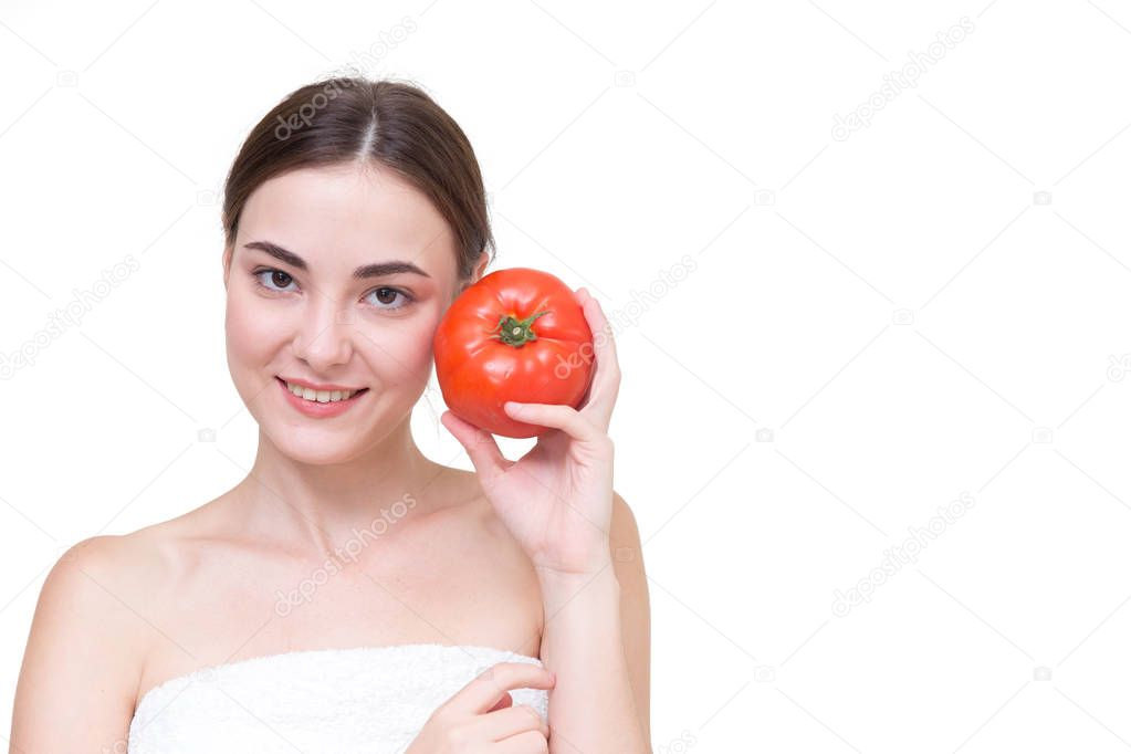 Beautiful women with tomato isolated on white