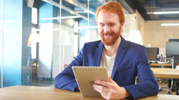 Online Video Chat on Tablet in Office, Red Hairs