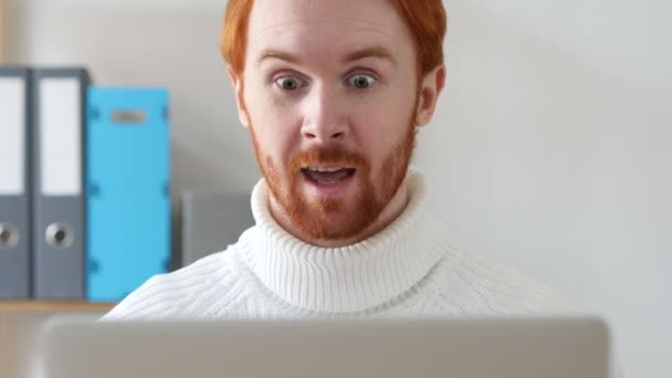 Close-up of  Man with Red Hairs Celebrating Success with Excitement