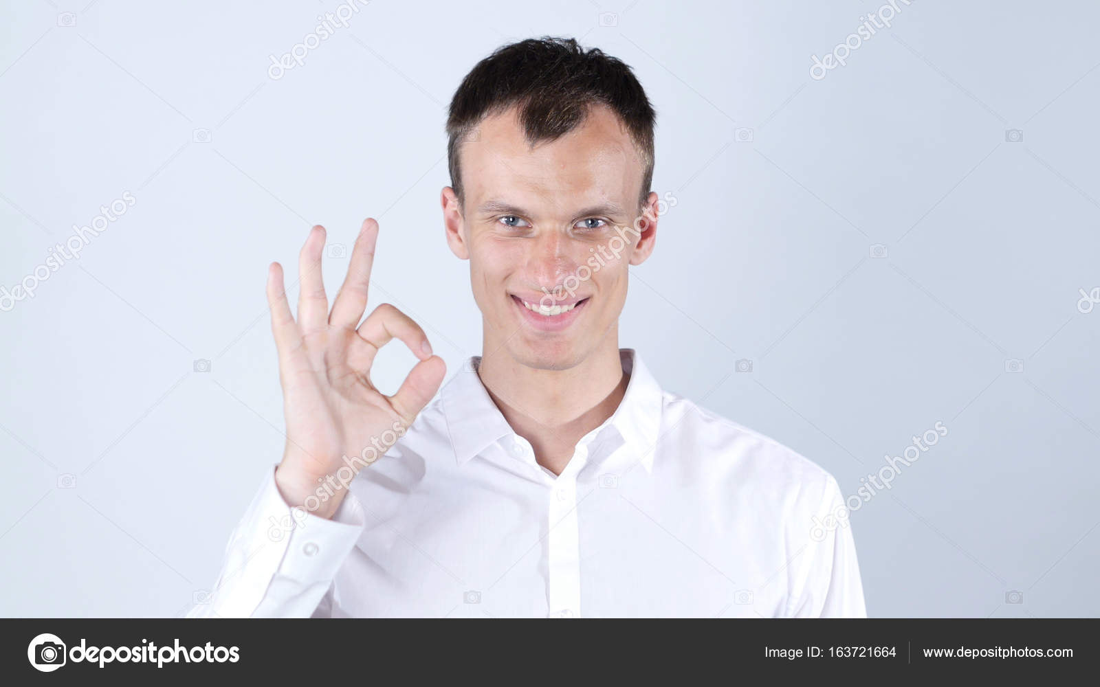 Young adult hand signs