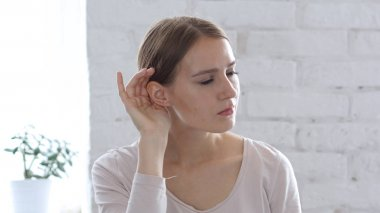 Listening Secret Carefully, Woman with Hand around Ear