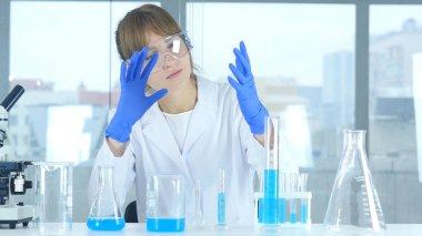 Female Scientist Imagining New Product in Laboratory, Creative