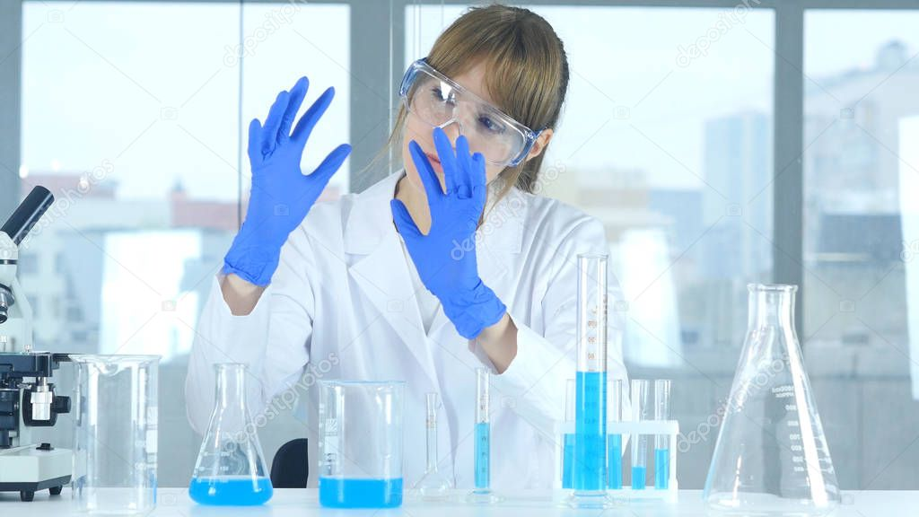 Female Research Scientist Imagining New Product in Laboratory, Creative