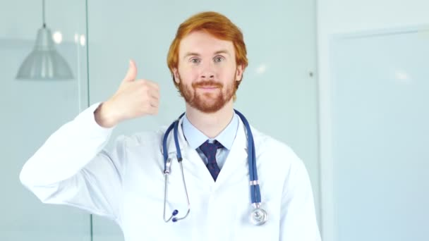 Portrait of Thumbs Up by Doctor in Clinic