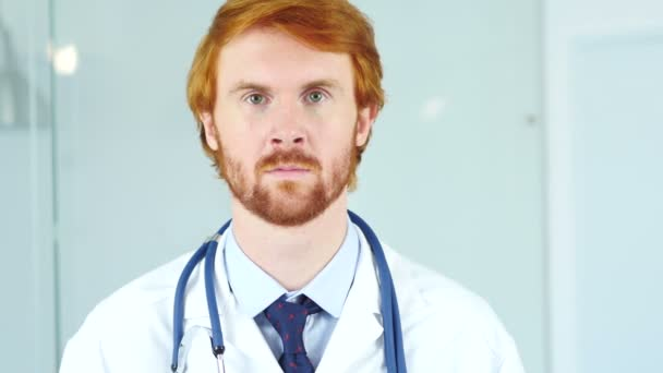 Close Up of Doctor Looking At Camera in Clinic