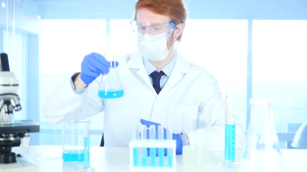 Research Scientist Looking at Blue Solution in Flask in Laboratory