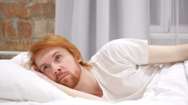 Thinking, Pensive Man Lying on Side and Dreaming while in Bed