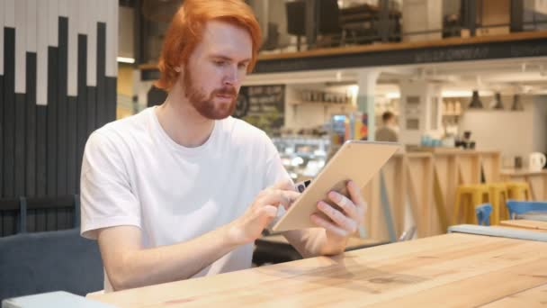 Man Reacting to Successful Online Shopping on Tablet in cafe, Payment
