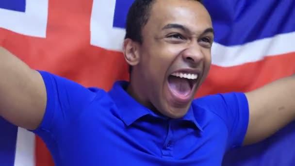 Icelandic Fan Celebrating while holding the Flag of Iceland in Slow Motion