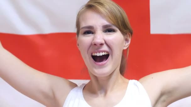 English Young Woman Celebrating while holding the Flag of England in Slow Motion