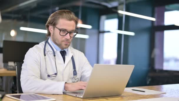 Doctor Working on Laptop in Clinic