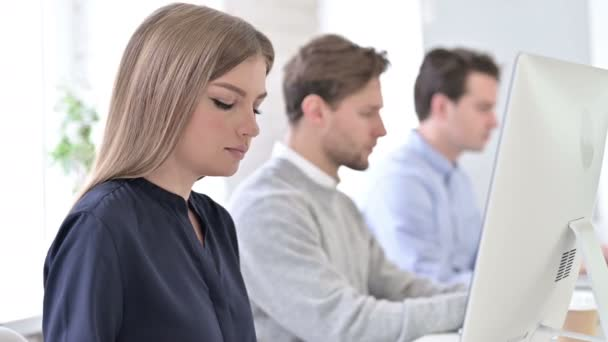 Creative Professionals using Laptops in Office