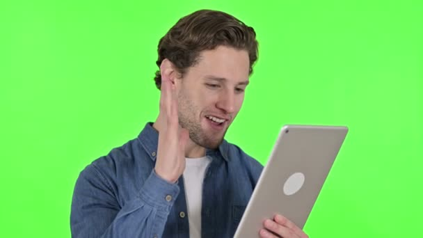 Online Video Chat on Tablet by Young Man on Green Chroma Key