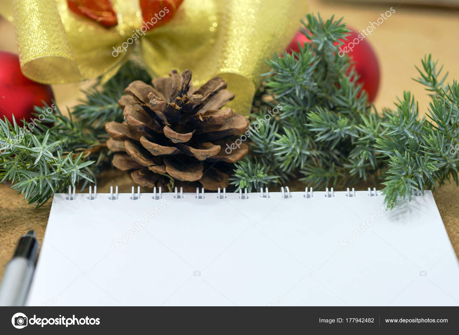 not completed list of goals in a notebook on a wooden table with christmas decorations and