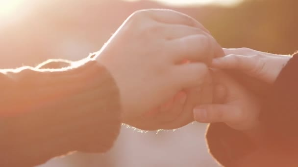 man placing engagement ring in womans finger