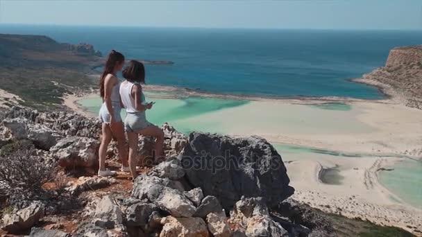 Happy women enjoying summer on high cliff