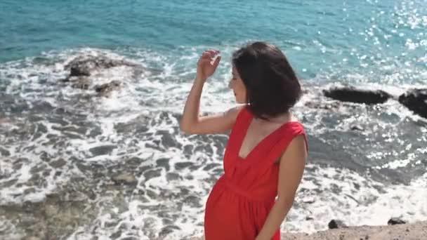 Young woman posing near ocean waves