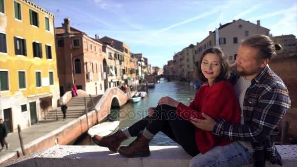 Couple in love on a bridge in Venice