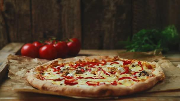 Italian pizza on wooden table