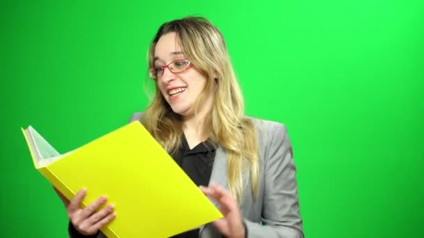 Office manager with a report folder. She studying records. Happy and agrees with the results. Green screen background.