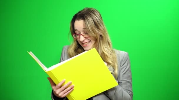 Office manager with a report folder. Looks at records. Happy and agrees with the results. Green screen background.