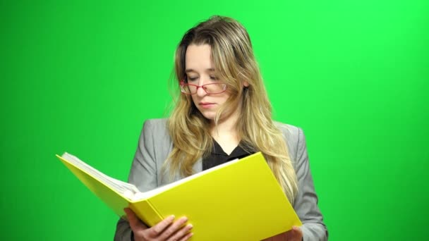 Office manager with a report folder. Studying records. Smirk on the face. Green screen background.