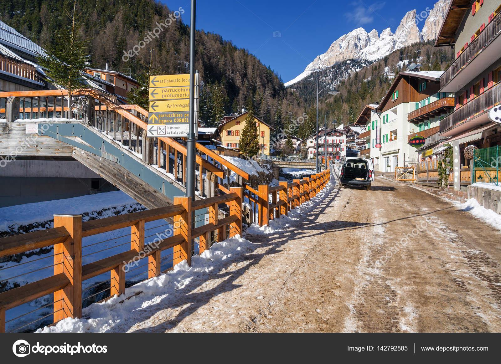 Trentino Alto Adige Artigianato sunny view of campitello on the background of dolomites of