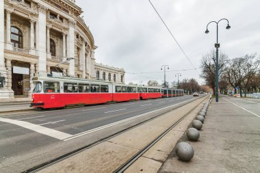 Cloudy view of Wiener Ringstrasse with historic Burgtheater (Imp
