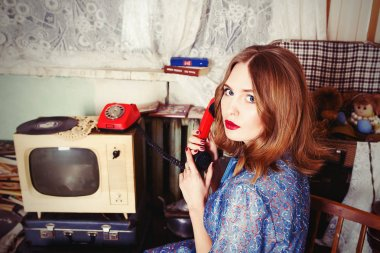 portrait of beautiful blonde woman with retro telephone in soviet union interiour