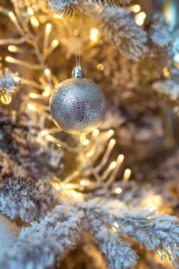 beautiful blue and silver christmas decorations on christmas tree on garland background