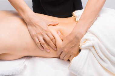 Anti-cellulite massage of thick sides