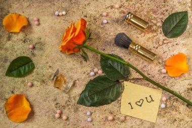 Still life of pop female things - flower, perfume, ball powder,