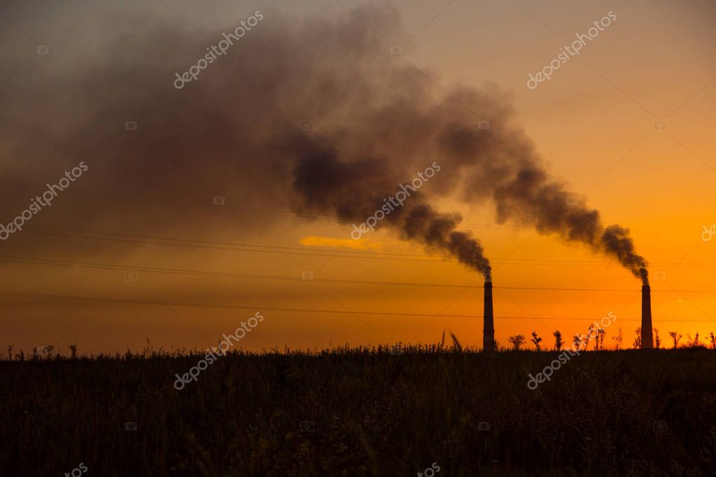 Industrial smoke from chimney at sunset, steppe near Almaty, Kaz