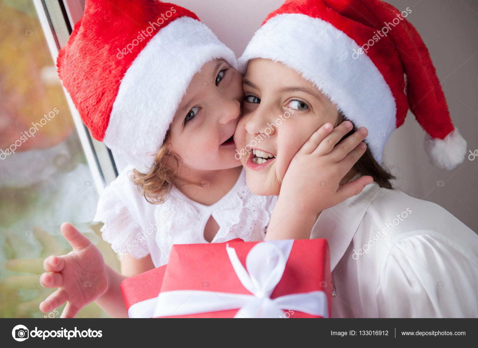 two cute little girls with Christmas gifts — Stock Photo ...