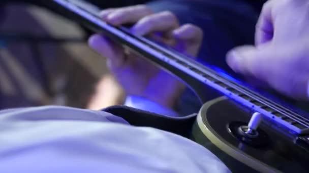 rock musician playing electric guitar. Close-up