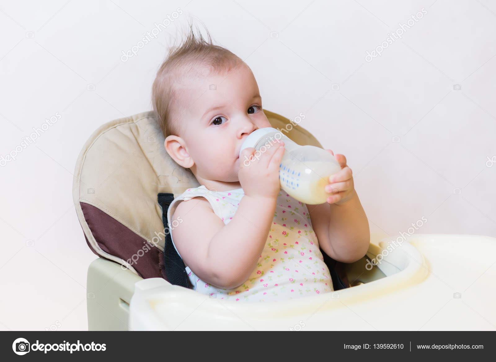 Boy sucks milk