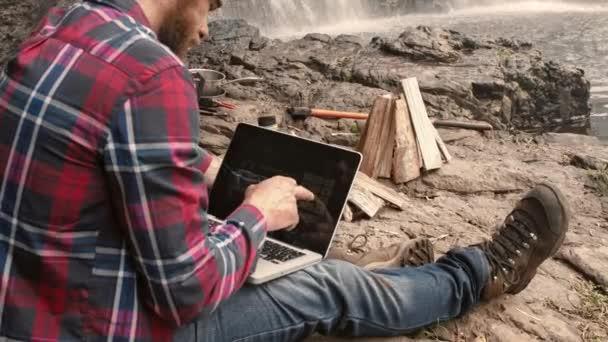 trekker using banking app on touchscreen