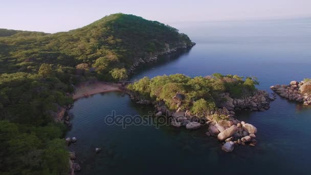 Aerial drone quadcopter of luxury water front hotel resort on island,  rustic eco bungalow accommodation on exotic island in lake Malawi