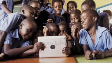 Touch screen tablet computer in African class room.