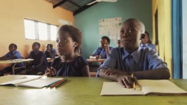 Classroom of African children learning English.