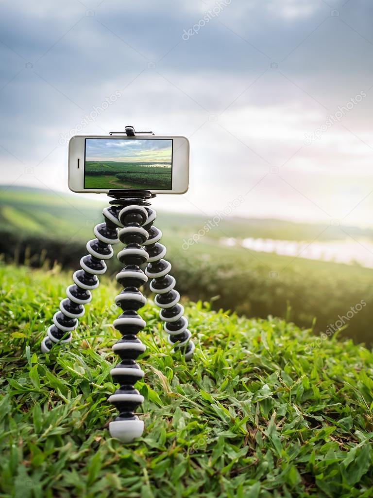 Smartphone take a landscape photo on tripod