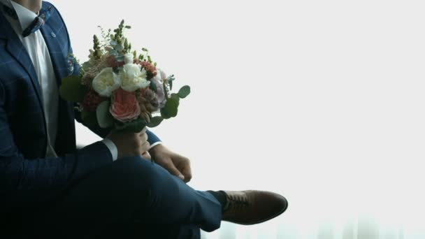 Groom with a bouquet of flowers, wedding flowers with orchids and roses for special event