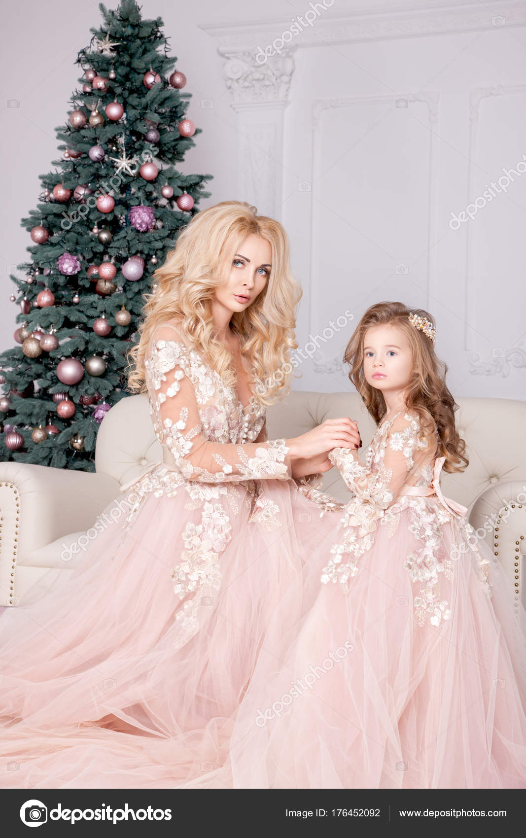 Christmas Gifts For Mom From Daughter.Mom Daughter Wearing Pink Dresses Holding Christmas Gifts