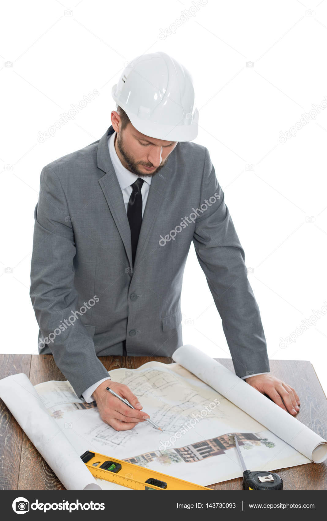 Handsome mature contractor drawing a building plan — Stock
