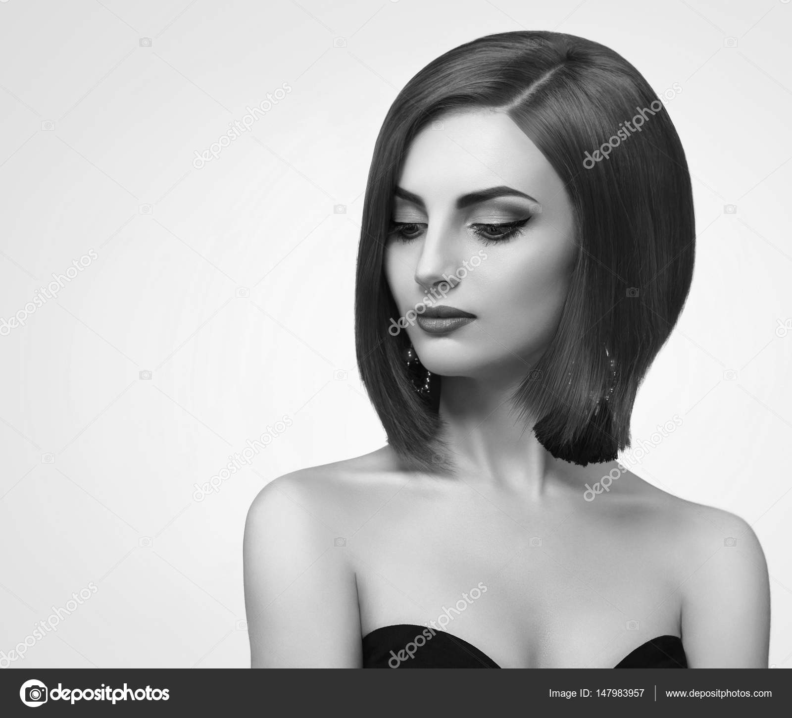 Black and white studio shots of a classy young woman with short stock image