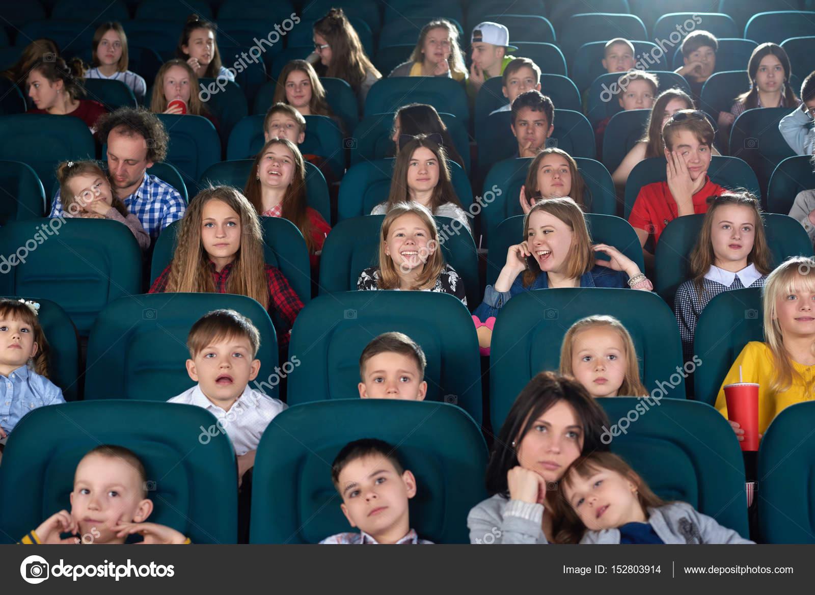 children watching movies at the cinema stock photo serhii bobyk
