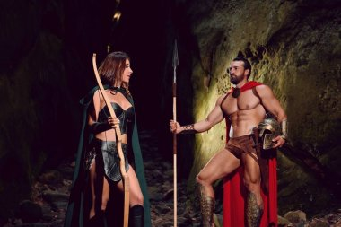 Spartan warrior and his woman in the woods
